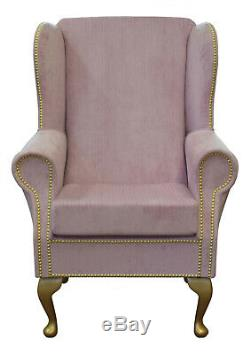 High Wingback Fireside Chair in Blossom Pink Fabric with Gold Studding detail