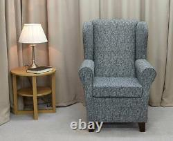 Wingback Fireside Armchair Chair in a Como Charcoal Grey Fabric Extended Base